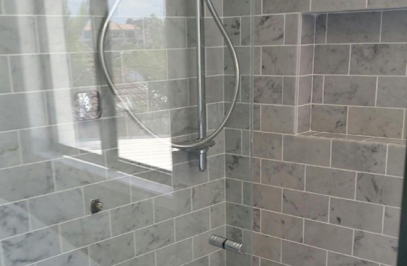 Kitchen Bathroom Renovations - Gold Coast - Decorated bathroom with hand shower