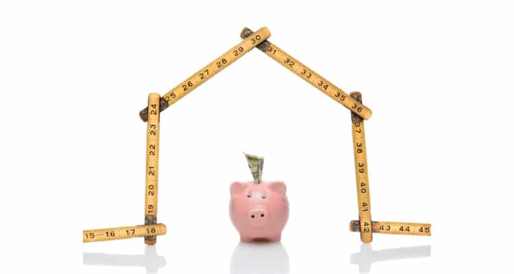 piggy bank under a house of tape measures