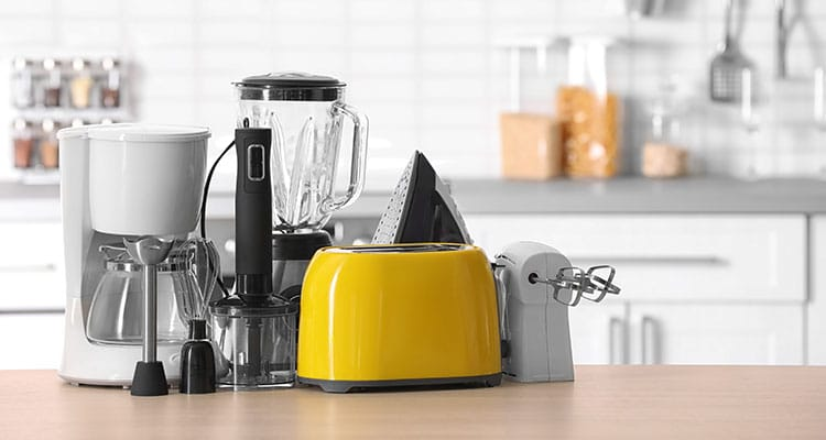 Various kitchen appliances on a kitchen island
